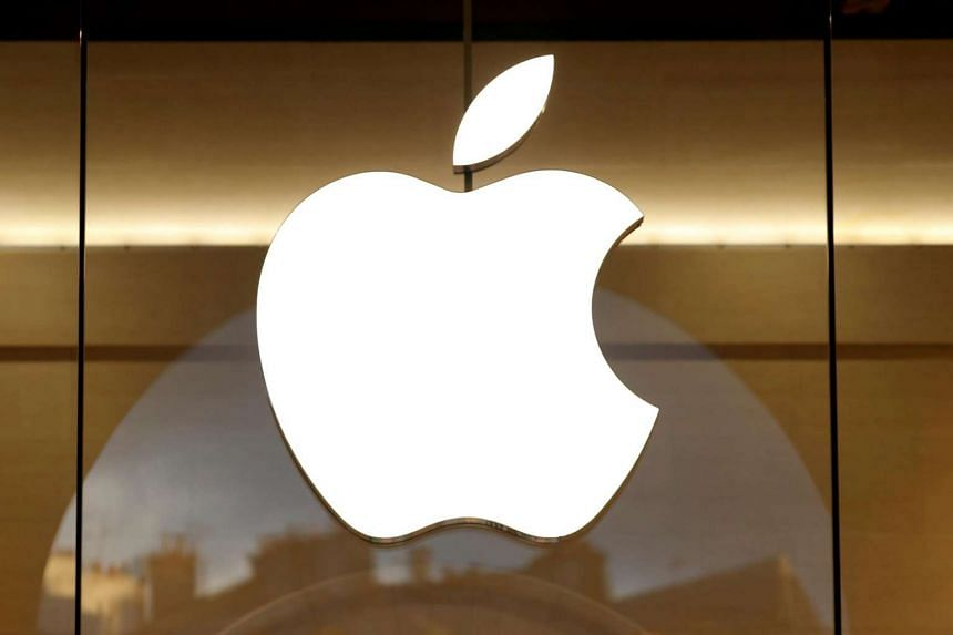 The Apple logo is seen on the facade of an Apple Store in Paris.