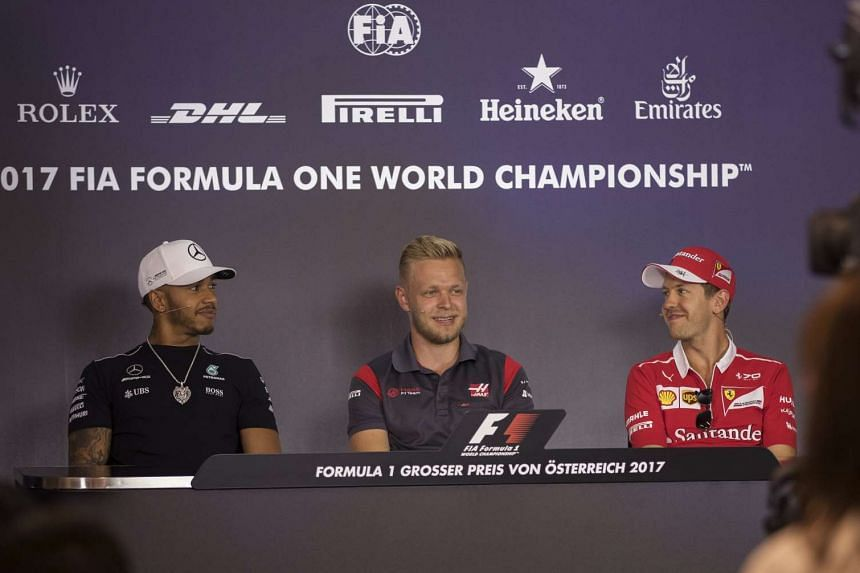 Hamilton (left), Kevin Magnussen (centre) and Vettel (right) at a joint press conference, July 6, 2017.