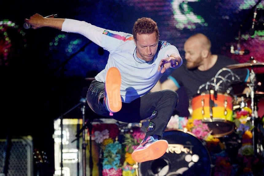 Chris Martin of the Coldplay performs during the One Love Manchester benefit concert for the victims of the Manchester Arena terror attack at Emirates Old Trafford, Greater Manchester, Britain on June 4, 2017.