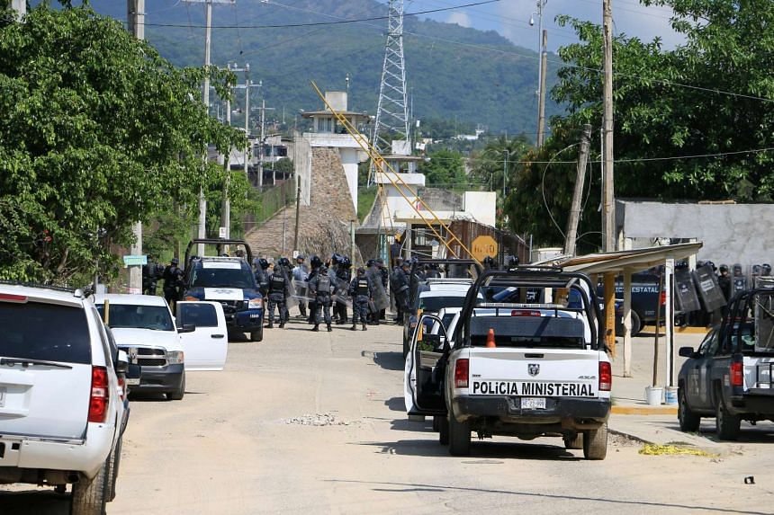 Riot police line up outside the prison in Acapulco, Mexico, July 6, 2017.
