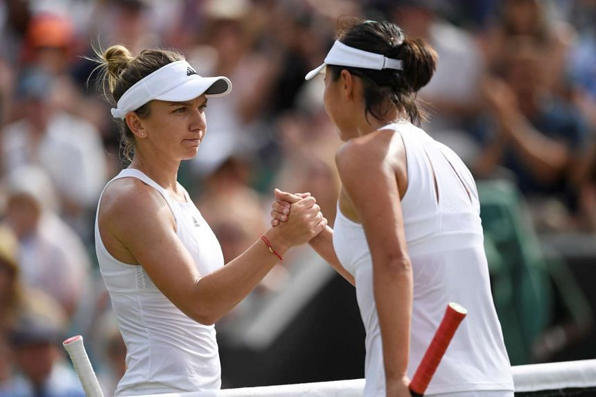 Halep shakes hands with China's Shuai Peng after the match.