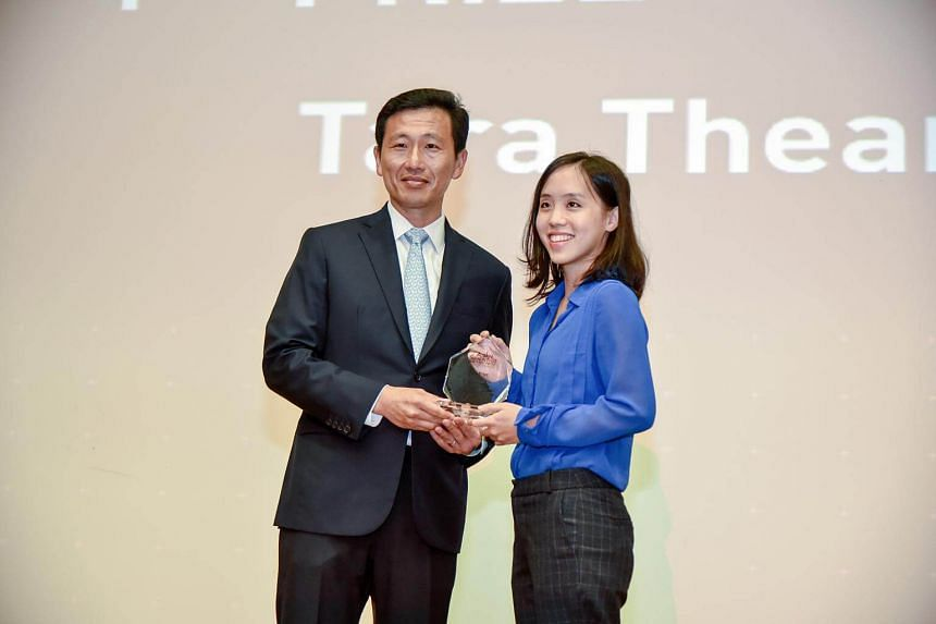 Ms Tara Thean, 26, receiving first prize of the Asian Scientist Writing Prize 2017 at Science Centre Singapore from Minister for Education (Higher Education and Skills), Mr Ong Ye Kung on July 7.