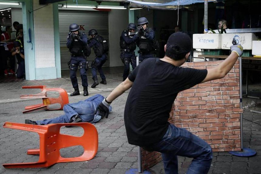 """Singapore's Emergency Response Team shooting a """"terrorist"""" during a counter-terrorism exercise on May 28, 2017."""