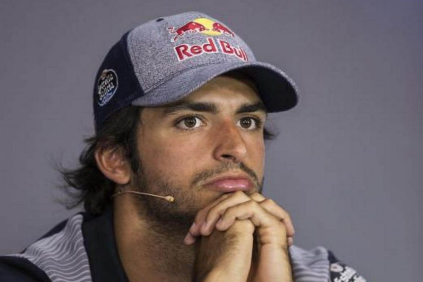 Spanish Formula One driver Carlos Sainz of Scuderia Toro Rosso reacts during a press conference at the Red Bull Ring circuit in Spielberg, Austria, on July 6, 2017.