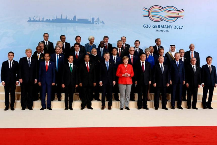 The world leaders pose for a family photo at the G20 leaders summit in Hamburg, Germany on July 7, 2017.
