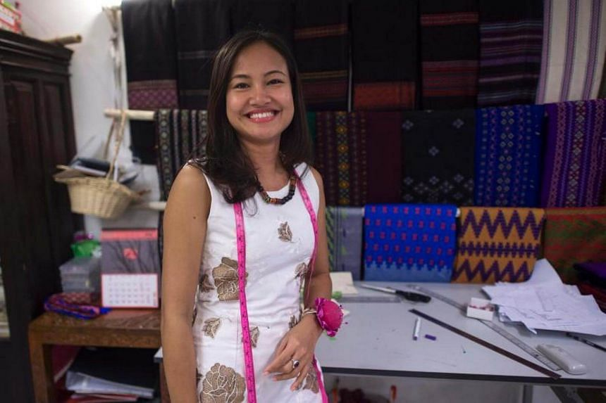 Boutique owner Pyone Thet Thet Kyaw (right), owner and designer of Virya Couture, posing at her shop at Yangon, on July 5, 2017.