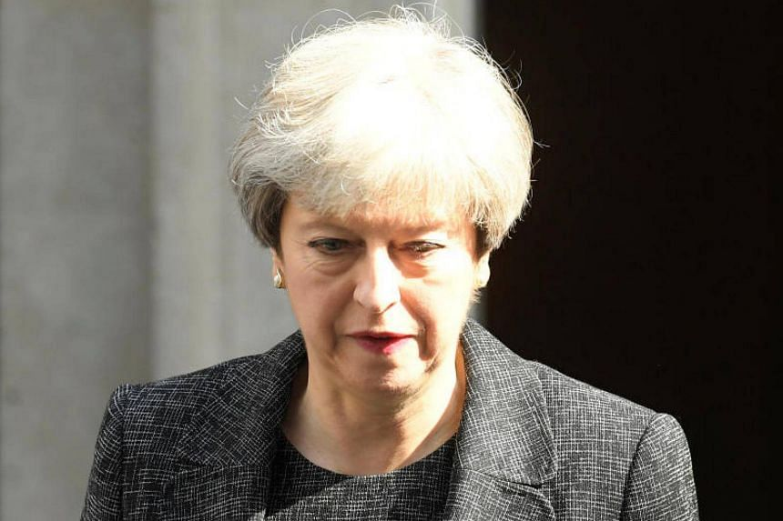 British Prime Minister Theresa May leaves 10 Downing Street in central London.