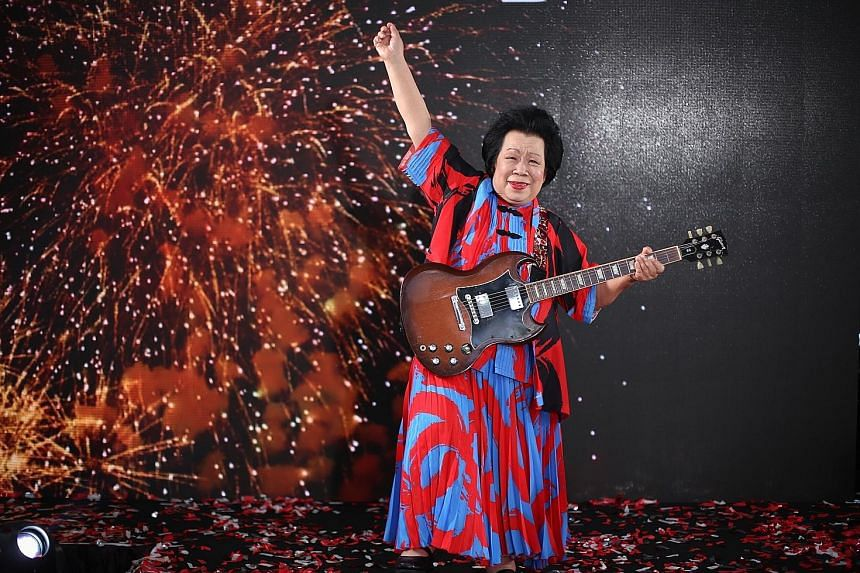 Madam Mary Ho, 81, the NDP's oldest performer, said she first learnt to play the acoustic guitar when she was 60. But the allure of rock and blues music made her pick up the electric guitar a few years later.