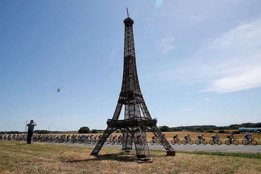 It's still a long way to go before the finale in Paris, even as the pack of riders cycled past a replica of the Eiffel Tower during yesterday's Stage 6. Three-time Tour winner Chris Froome leads the race.