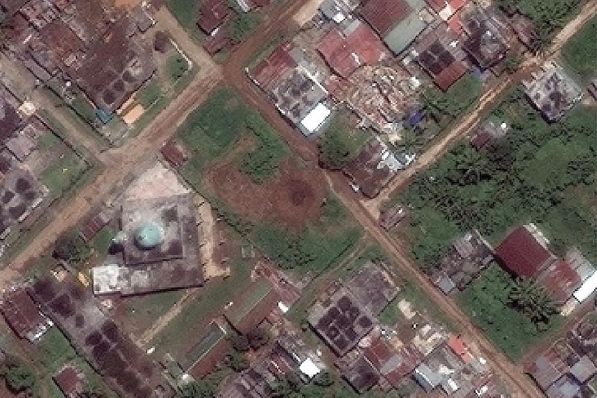 Left: The Masjed Mindanao Islamic Centre stands intact even as much of the surrounding area has been flattened, in what could be a deliberate move by the authorities. It is believed militant leader Isnilon Hapilon is hiding there, surrounded by hosta