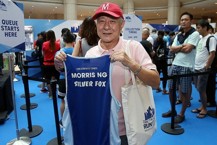 Mr Morris Ng, who was first in line to collect his ST Run race pack at Suntec City yesterday, customised his race vest for $15.