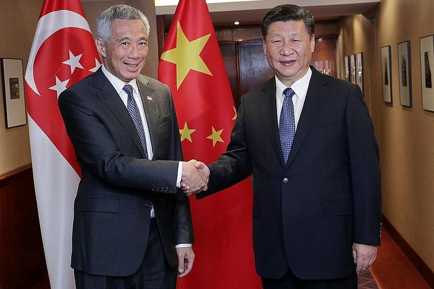 Prime Minister Lee Hsien Loong meeting Chinese President Xi Jinping in Hamburg, Germany, yesterday.