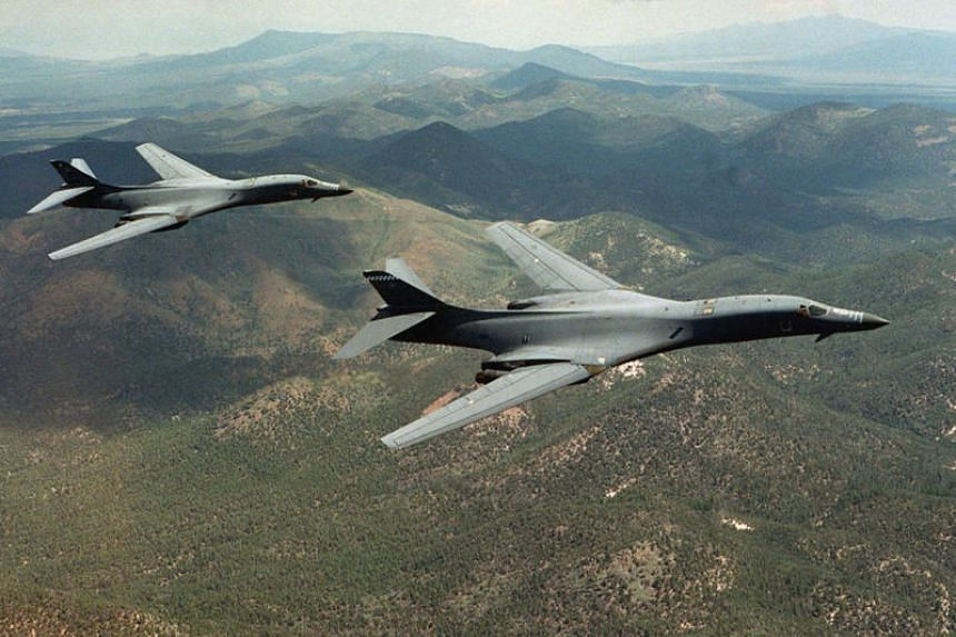 A pair of B-1B Lancer bombers soar over Wyoming in an undated file photo.