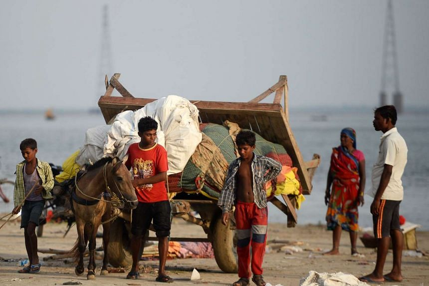 Indian vendors on the banks of the Ganga river, in Allahabad on July 6, 2017.