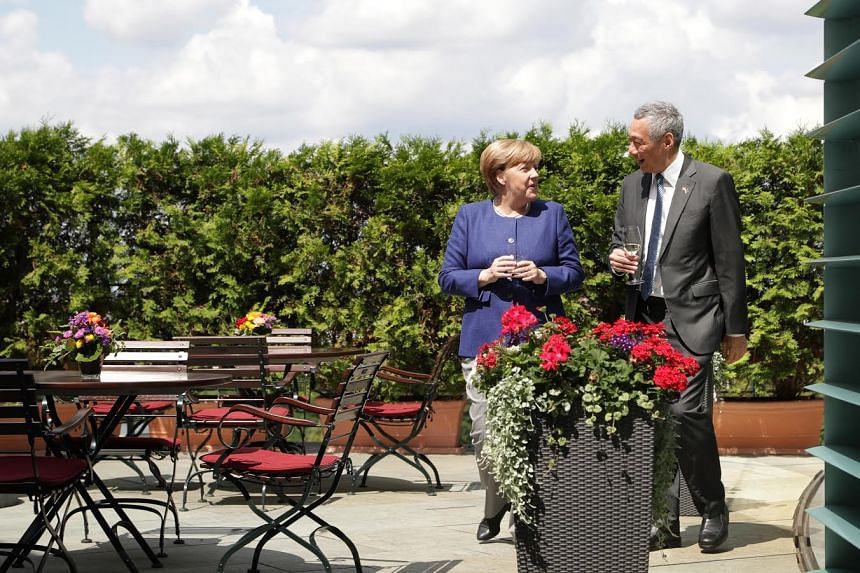 PM Lee Hsien Loong (right) and Chancellor Angela Merkel pose for a photo ahead of the Group of 20 (G-20) Leaders' Summit.