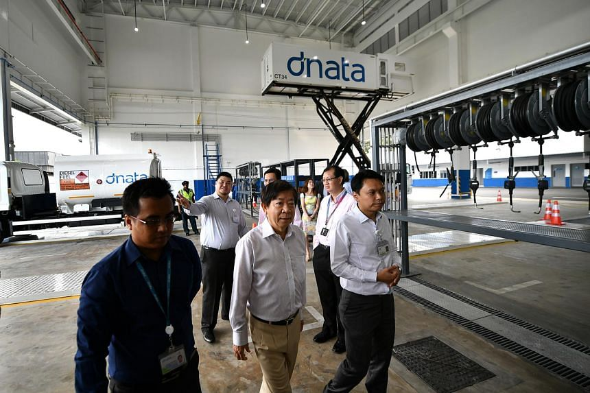 Coordinating Minister for Infrastructure & Minister for Transport Mr Khaw Boon Wan (centre) touring the new dnata facility at Changi Airport.