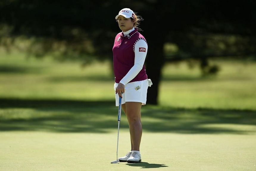 Ariya Jutanugarn of Thailand waits to putt on the 15th green during the first round of the Meijer LPGA Classic.