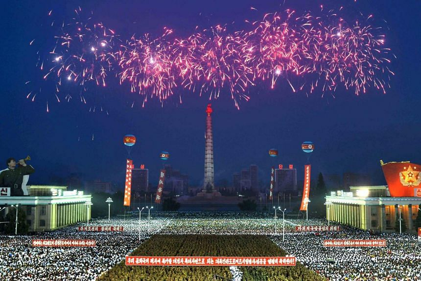 Army personnel and people gather at Kim Il Sung Square in Pyongyang on July 6, 2017 to celebrate the successful test-launch of intercontinental ballistic rocket Hwasong-14.