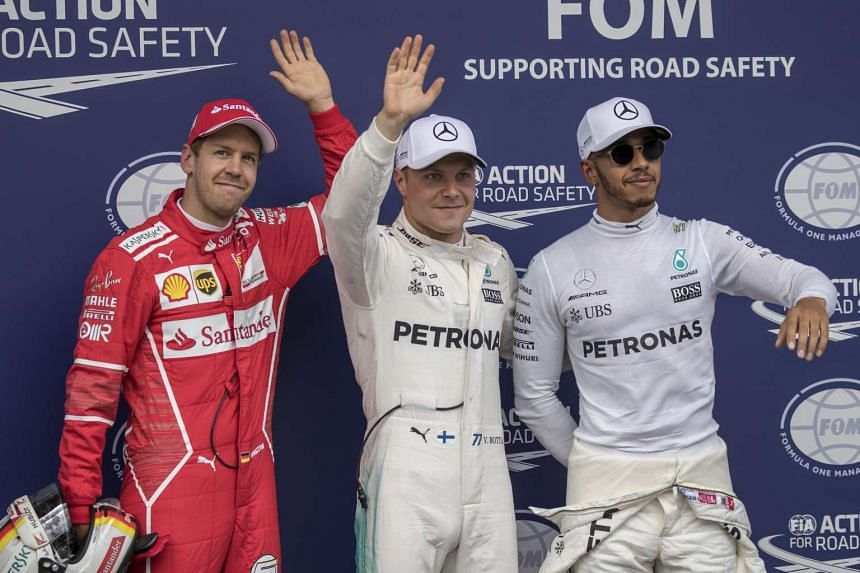 (From left) Vettel, Bottas and Hamilton celebrate after the qualifying session.