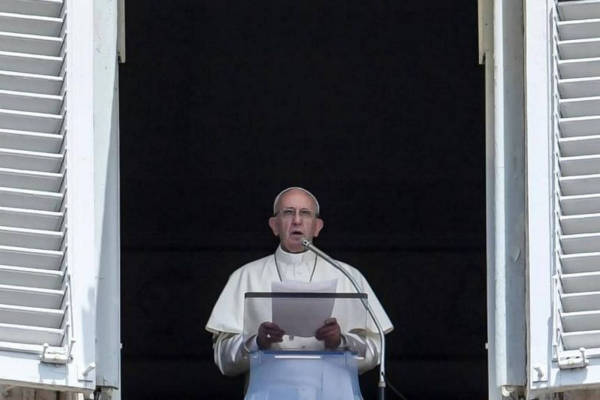 Pope Francis delivers his speech to the crowd from the window of the apostolic palace overlooking St Peter's square during the Sunday Angelus prayer in Vatican, on July 2, 2017.