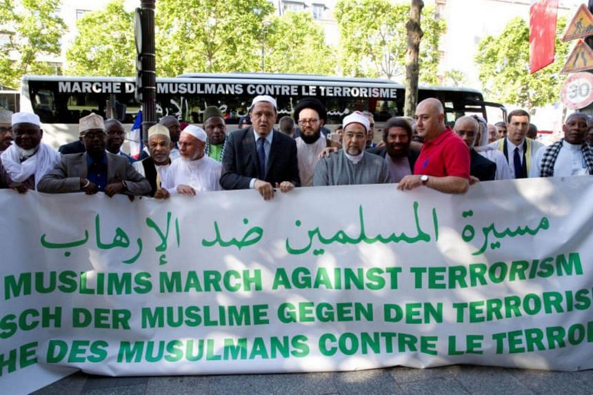 French-Jewish writer Marek Halter and Imam Hassen Chalghoumi are seen between other religious leaders at the start of a European tour to the sites of recent Islamist attacks in Champs-Elysees, Paris, France on July 8, 2017.
