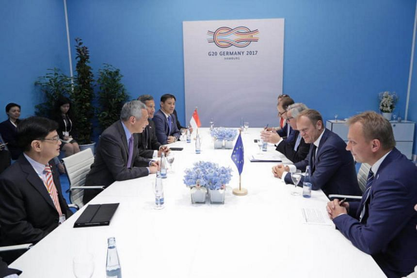 Prime Minister Lee Hsien Loong meets President of the European Council Donald Tusk and President of the European Commission Jean-Claude Juncker at the G20 Summit on July 8, 2017.