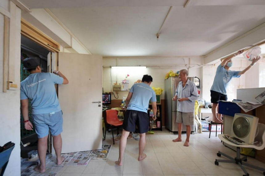 Resident Low Chin Hee a former painter, has his Chai Chee Avenue apartment spruced up by volunteers William Tan, Bryan Teo, Caleb Low and Agnes Lim.