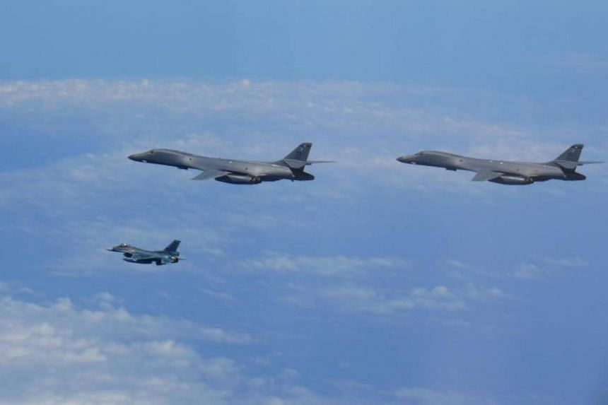 Two US Air Force B-1B Lancers assigned to the ninth Expeditionary Bomb Squadron, deployed from Dyess Air Force Base, Texas, USA, flying with a Koku Jieitai JASDF F-2 fighter jet over the East China Sea, on July 7, 2017.