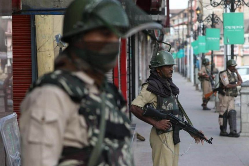 Indian paramilitary soldiers stand guard during restrictions in Lal chowk area of Srinagar, the summer capital of Indian Kashmir, on July 8, 2017.