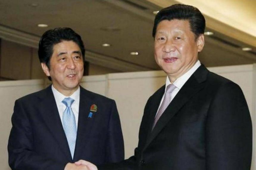 Japan's Prime Minister Shinzo Abe (left) shakes hands with China's President Xi Jinping at the start of their bilateral meeting on the side lines of the Asian-African Conference in Jakarta, on April 22, 2015.