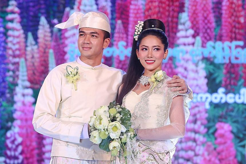 Models showing off ethnic wear at a fashion show at the National Theatre in Yangon on June 30. New designers are trying to reshape the country's sweatshop model.