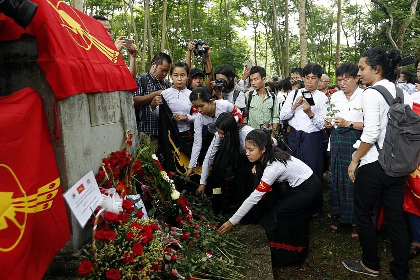 Representatives from the All Burma Federation of Student Unions at a service (left) held every year in memory of those killed during a crackdown on a student protest at the university (above) on July 7, 1962. Myanmar citizens living in Thailand prote