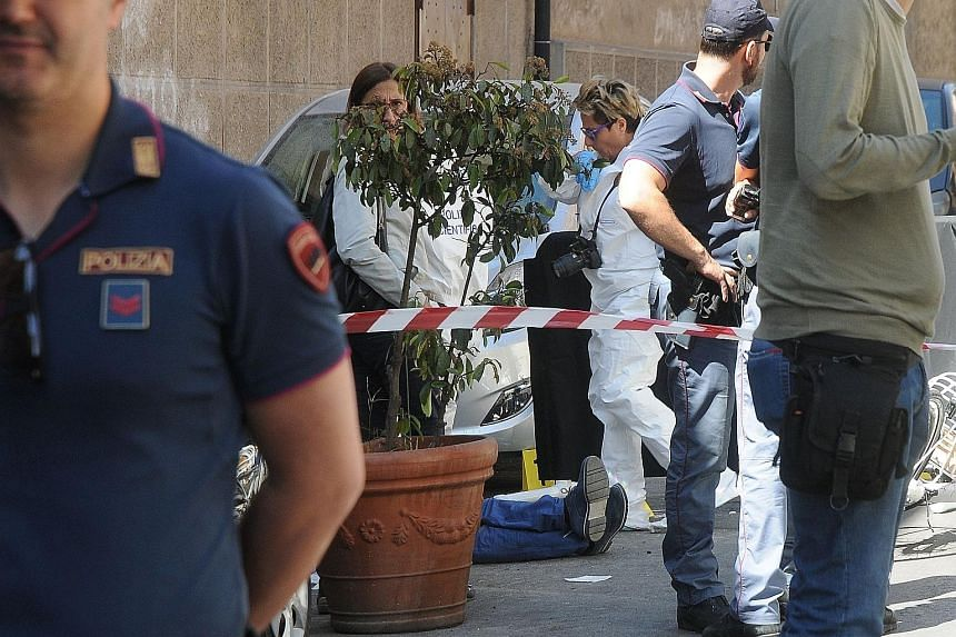 "Italian police at the scene where a mafia boss was gunned down. The programme dubbed ""Liberi di Scegliere"" (Free to Choose) has so far seen 40 young people sent to live with foster families or in communities in secret places, where they learn about l"