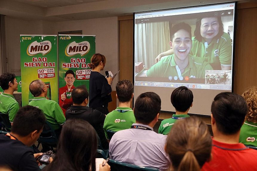 Swim star Joseph Schooling and his mother May speaking to guests and the media in a live Skype session from Texas. Milo Singapore has appointed the national sporting icon and Olympic gold medallist as the new Milo Gao Siew Dai ambassador.
