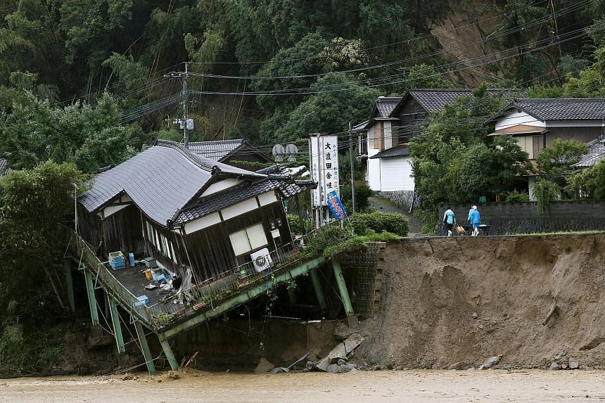 Many people were still unaccounted for yesterday following severe flooding across wide swathes of Japan's south-western main island of Kyushu, which continued to be battered by torrential rain. At least six people have died and a massive search and