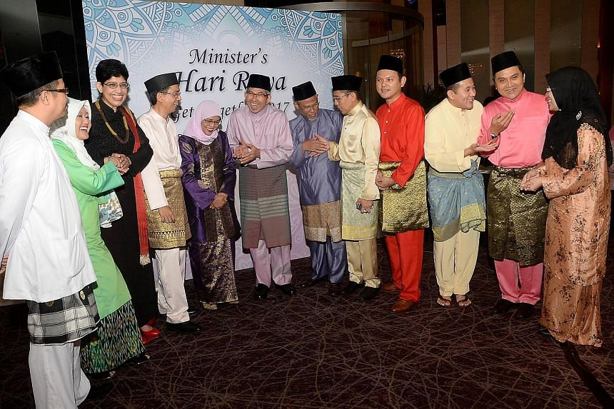 Minister-in-charge of Muslim Affairs Yaacob Ibrahim (centre) with (from far left) MPs Zainal Sapari, Rahayu Mahzam and Fatimah Lateef; Senior Parliamentary Secretary for Education and Social and Family Development Faishal Ibrahim; Speaker of Parliame