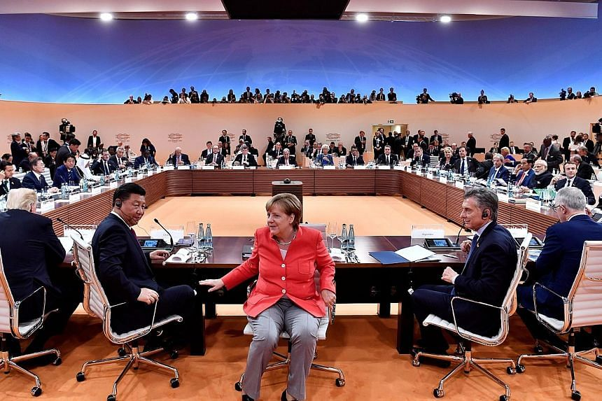 (From left) US President Donald Trump, Chinese President Xi Jinping, German Chancellor Angela Merkel, Argentinian President Mauricio Macri and Australian Prime Minister Malcolm Turnbull at the start of the first working session of the G-20 summit in