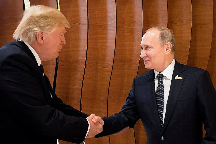 "US President Donald Trump meeting Russian President Vladimir Putin during the G-20 summit in Hamburg, Germany, yesterday. Mr Trump said as the meeting began that the two leaders ""look forward to a lot of positive things happening, for Russia, for the"