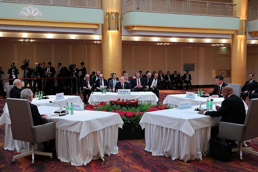 Clockwise, from foreground left: Brazilian President Michel Temer, Indian Prime Minister Narendra Modi, Russian President Vladimir Putin, Chinese President Xi Jinping and South African President Jacob Zuma at a Brics leaders' meeting on the sidelines