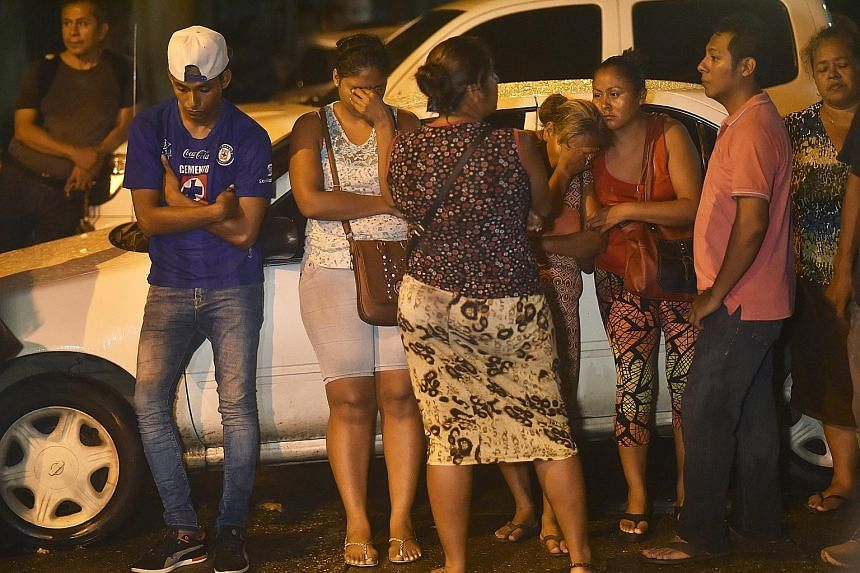 Relatives of inmates awaiting news of their loved ones outside the district attorney's office in Acapulco, Mexico, on Thursday after a riot left 28 inmates dead. State police have temporarily taken control of the prison, backed by federal police and