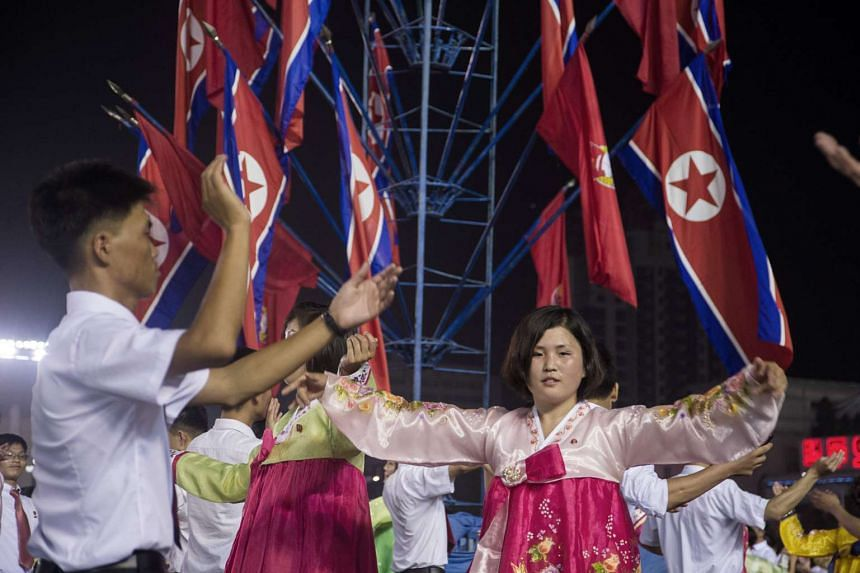 A July 6, 2017, photo shows celebrations marking the July 4 launch of the Hwasong-14 intercontinental ballistic missile, in Pyongyang.