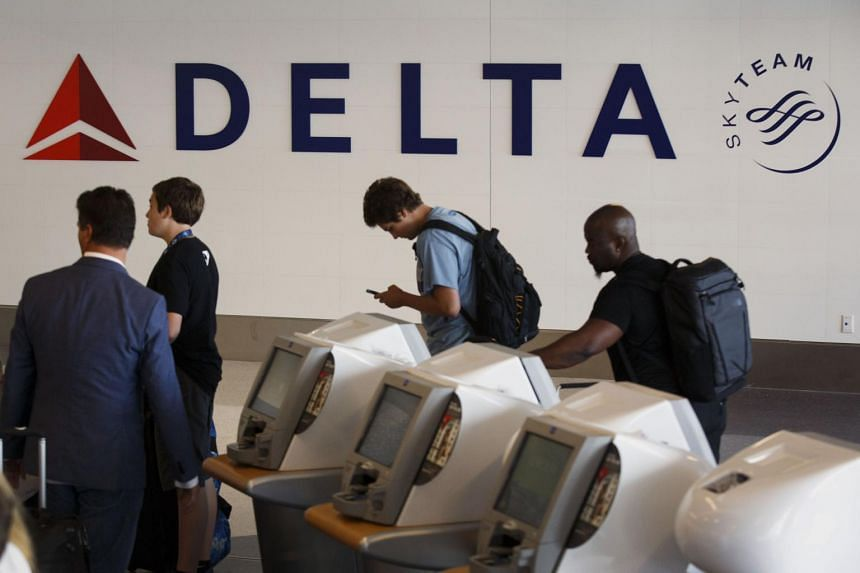 The Delta Air Lines signage is displayed at a self check-in kiosk in Terminal 5 at Los Angeles International Airport.