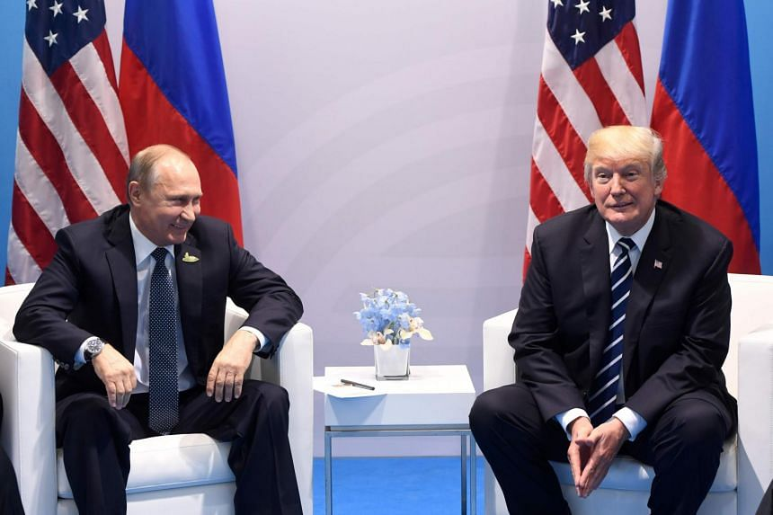 US President Donald Trump (right) and Russia's President Vladimir Putin holding a meeting on the sidelines of the G-20 Summit in Hamburg, Germany, on July 7, 2017.