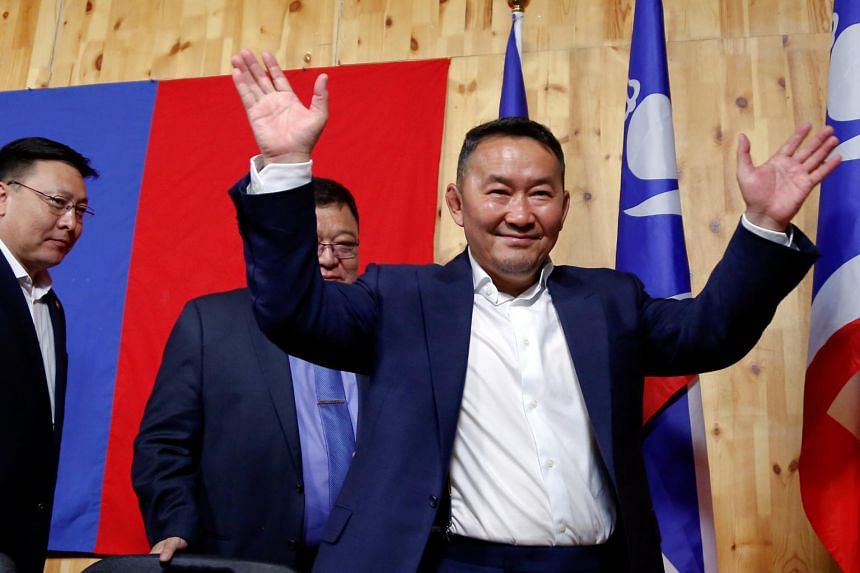 Populist former martial arts star Khaltmaa Battulga waves to reporters after addressing them in Ulaanbaatar, Mongolia, early July 8, 2017.