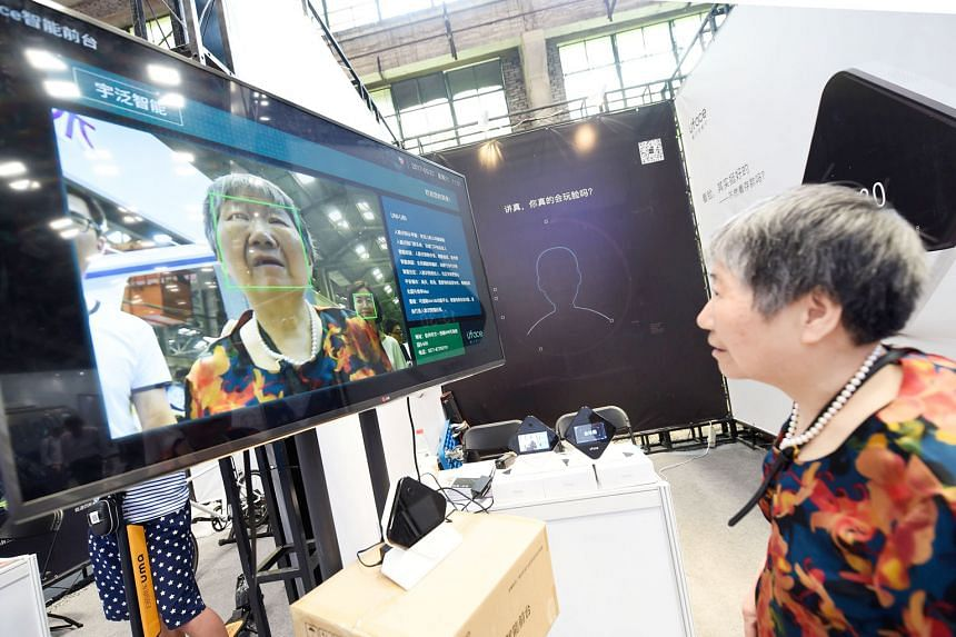 A woman looking at a screen displaying facial-recognition technology at the Hangzhou International Future Life Festival exhibition in May. Facial-recognition cameras are being used in China for routine activities such as withdrawing cash from an ATM,