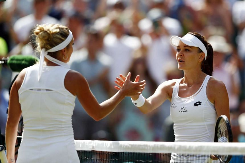 Radwanska (right) at the net with Timea Bacsinszky of Switzerland after their third-round match.