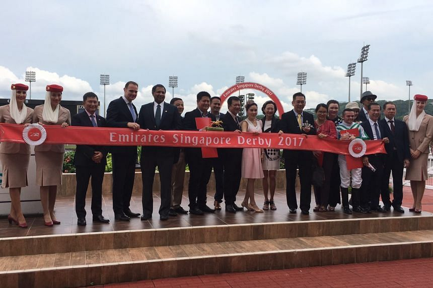 Trainer Alwin Tan and jockey Manoel Nunes are all smiles after winning the Singapore Derby 2017 with champion horse Infantry.