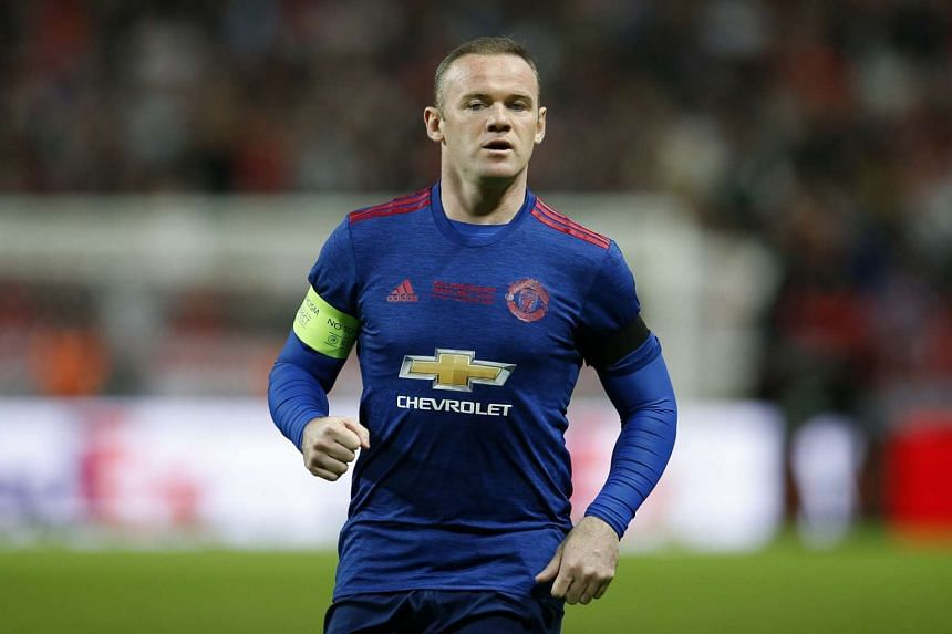Rooney (above, in a file photo) was pictured at Everton's training ground.