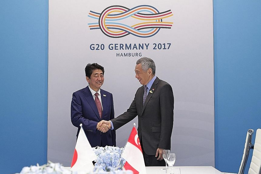 Prime Minister Lee Hsien Loong meeting Japanese Prime Minister Shinzo Abe yesterday.