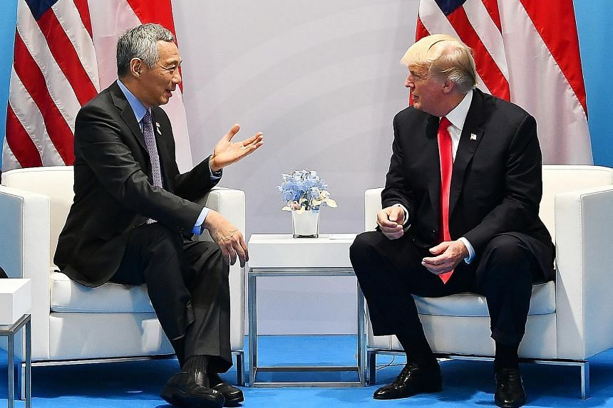Prime Minister Lee Hsien Loong meeting US President Donald Trump in Hamburg yesterday. They reaffirmed the two sides' excellent bilateral ties and committed to work together to advance relations.